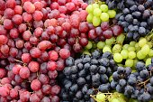 Organic bunch of colorful grapes for sale on a marketstall.