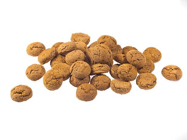 bunch of pepernoten cookies seen from side - kruidnoten stockfoto's en -beelden