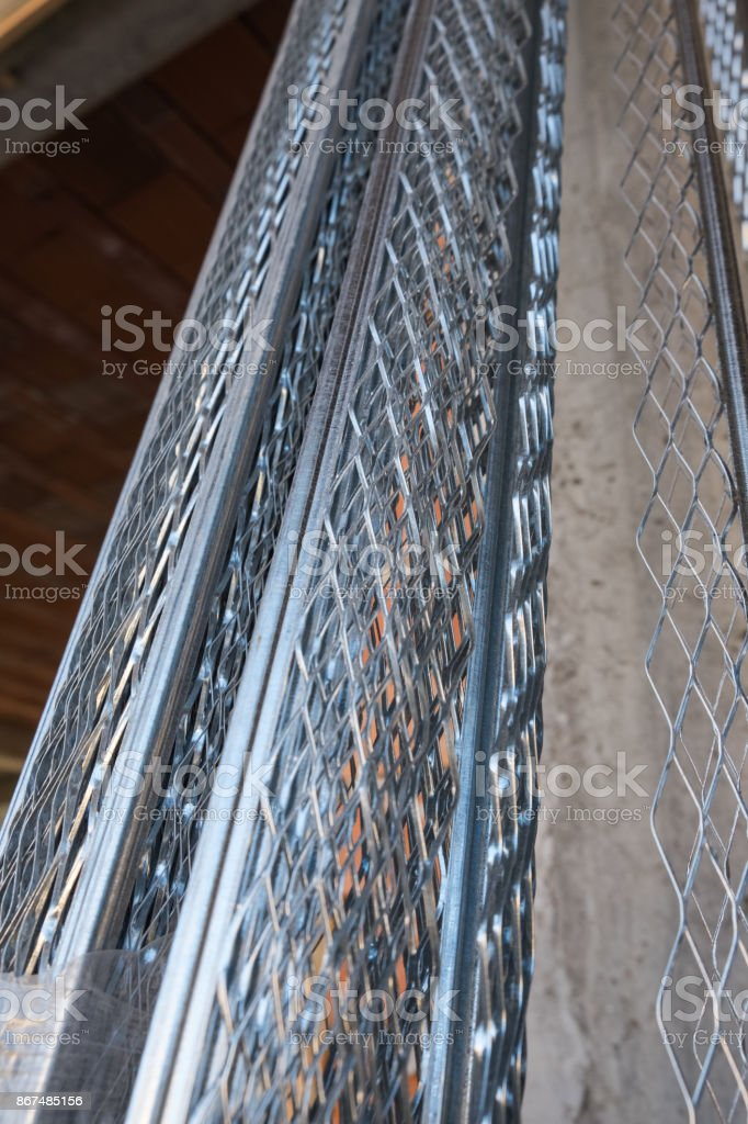 Bunch of plastering beads stock photo