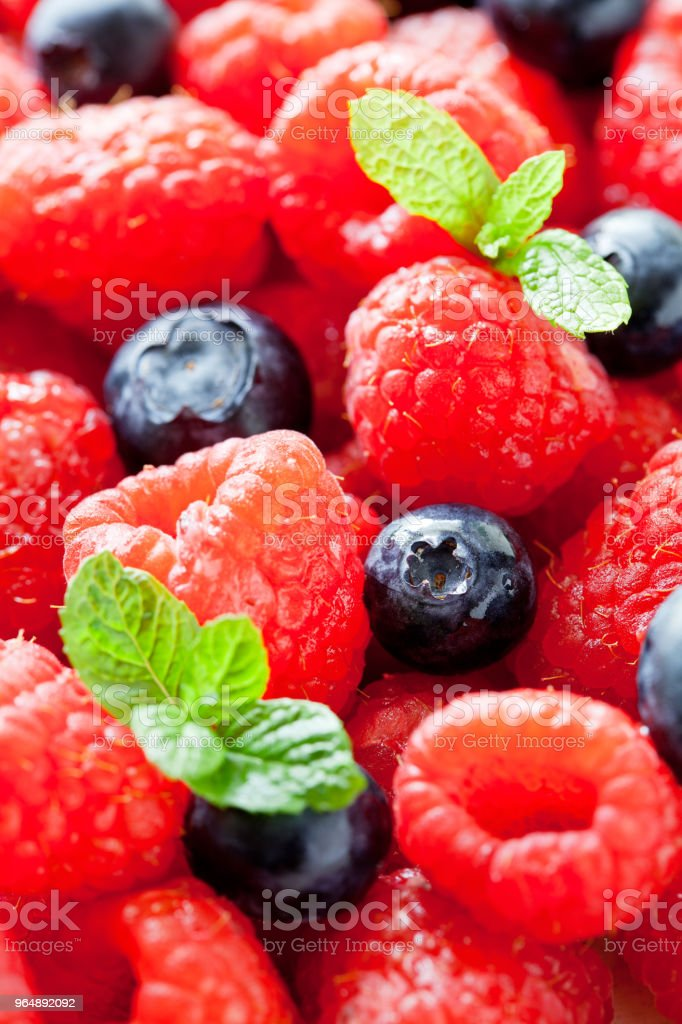 Bunch Of Raspberries And Blueberries With Mint Leaves royalty-free stock photo