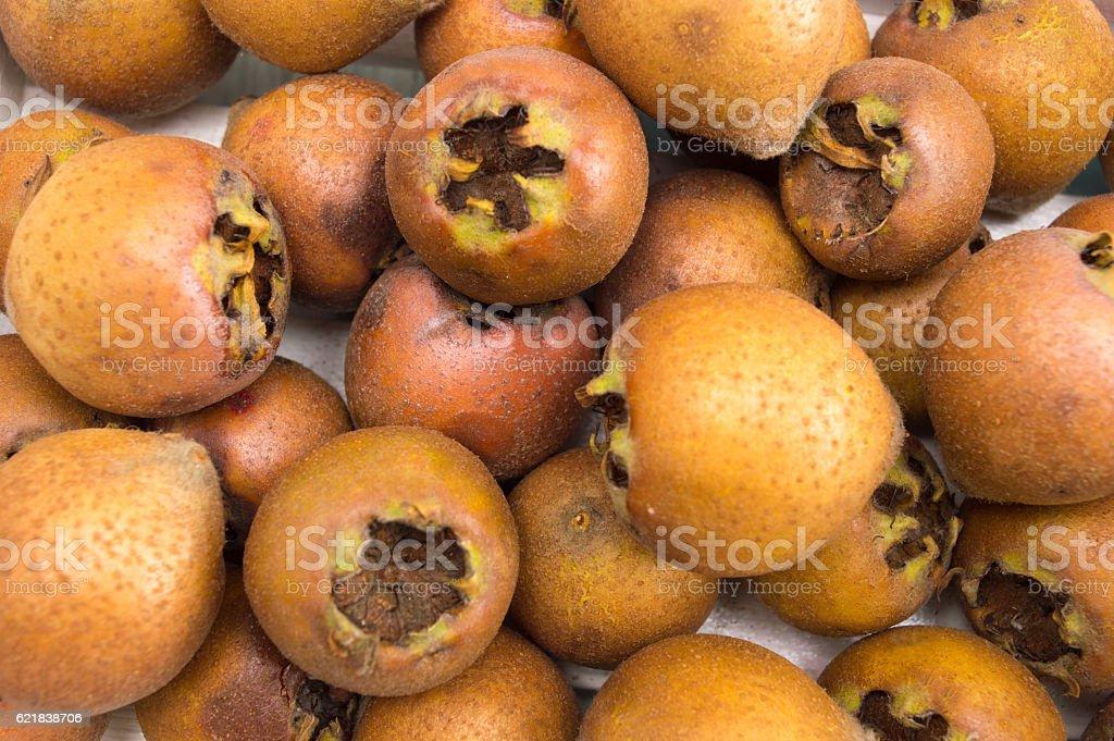 Bunch of raw medlar fruits background stock photo