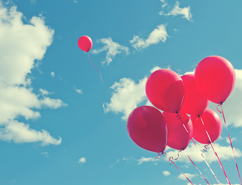 Bunch Of Red Ballons On A Blue Sky Stock Photo - Download Image Now