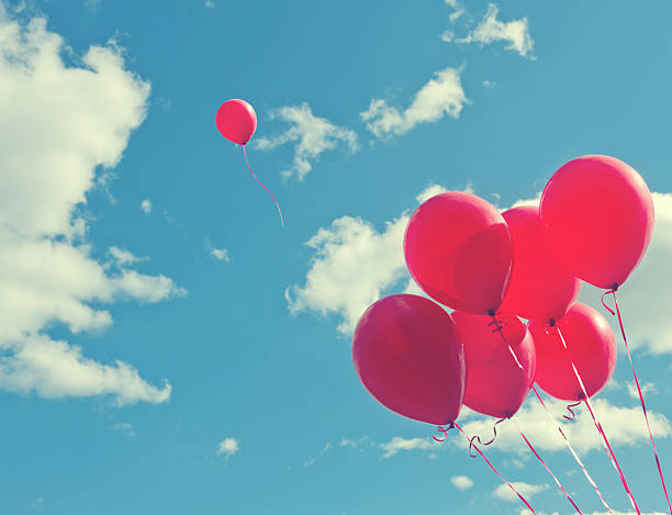 Bunch of red ballons on a blue sky stock photo