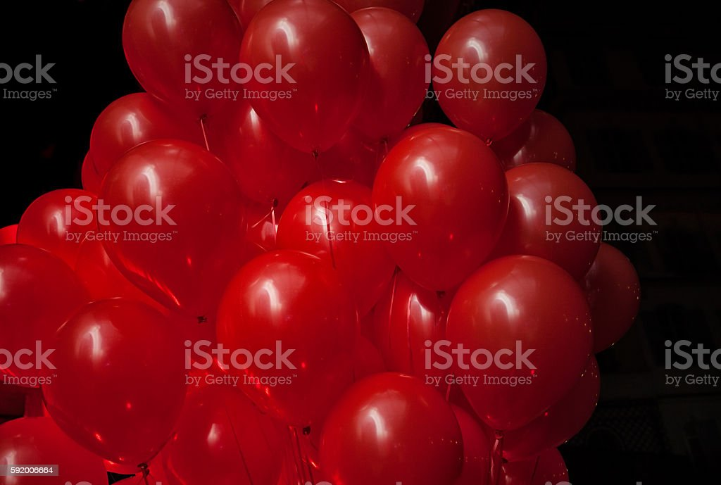 Bunch of red balloons on black stock photo