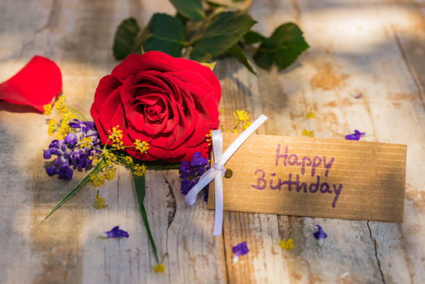 Bunch Of Red Rose Flower And Happy Birthday Greeting Card Stock Photo