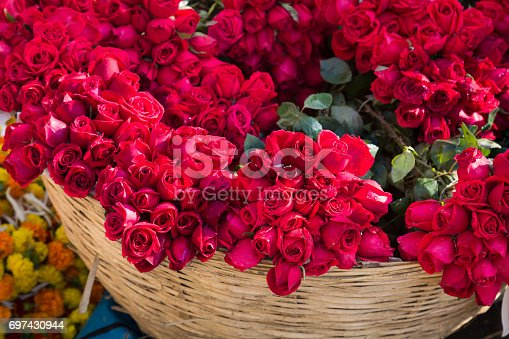 istock Bunch of red roses in a basket for background content. 697430944