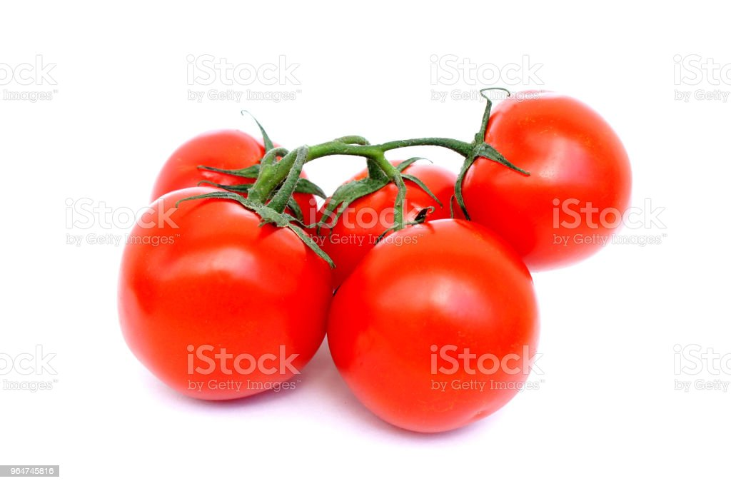 Bunch of ripe red tomato on a white background with a shadow. Close up. royalty-free stock photo