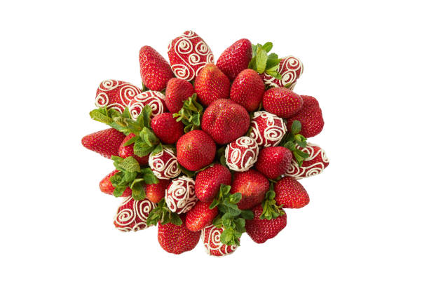 Bunch of ripe strawberries decorated with white chocolate and fresh mint on a white background stock photo