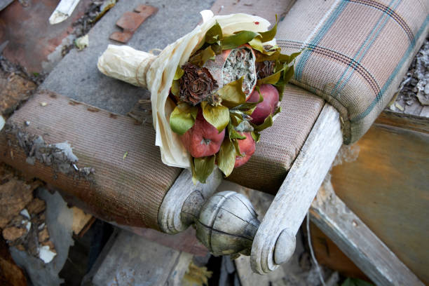 Bunch of rotten fruit and wilted flowers lay on the remnants of broken furniture Bunch of rotten fruit and wilted flowers lay on the remnants of broken furniture disavow stock pictures, royalty-free photos & images