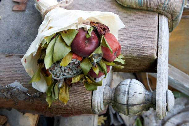 Bunch of rotten fruit and wilted flowers lie on the remains of old furniture Bunch of rotten fruit and wilted flowers lie on the remains of old furniture disavow stock pictures, royalty-free photos & images
