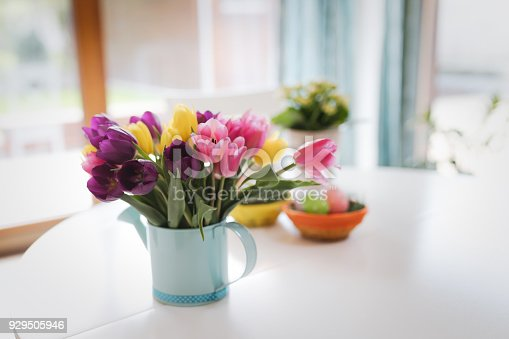 istock Bunch of spring tulips flowers with easter eggs 929505946