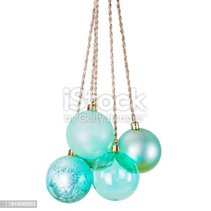 Isolated turquoise Christmas balls hanging on rough twine rope