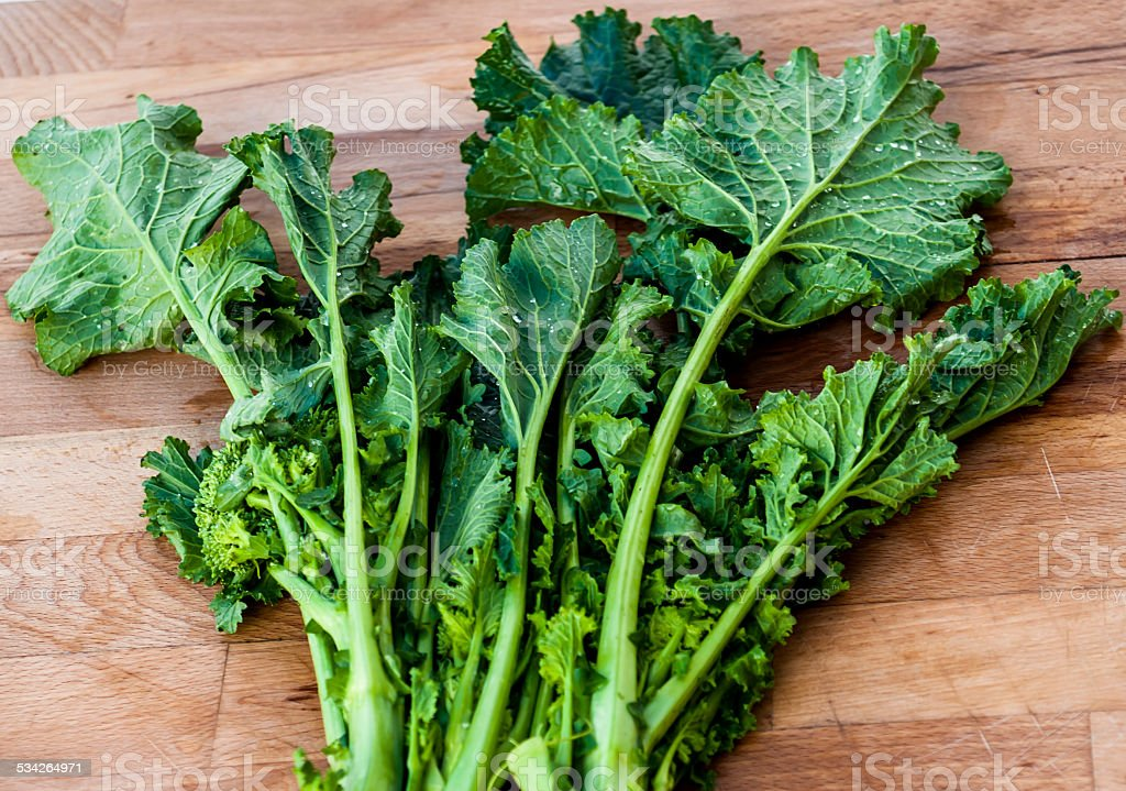 Bunch of vibrant green turnip 'cime di rapa'. Italian cuisine stock photo