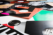 Kaliningrad, Russia - February 25, 2016: Bunch of different vinyl records on the floor. House and techno record labels such as: Hostom, Perlon, ODE, Double Standard, Ugold, Sensual, Memoria and etc.