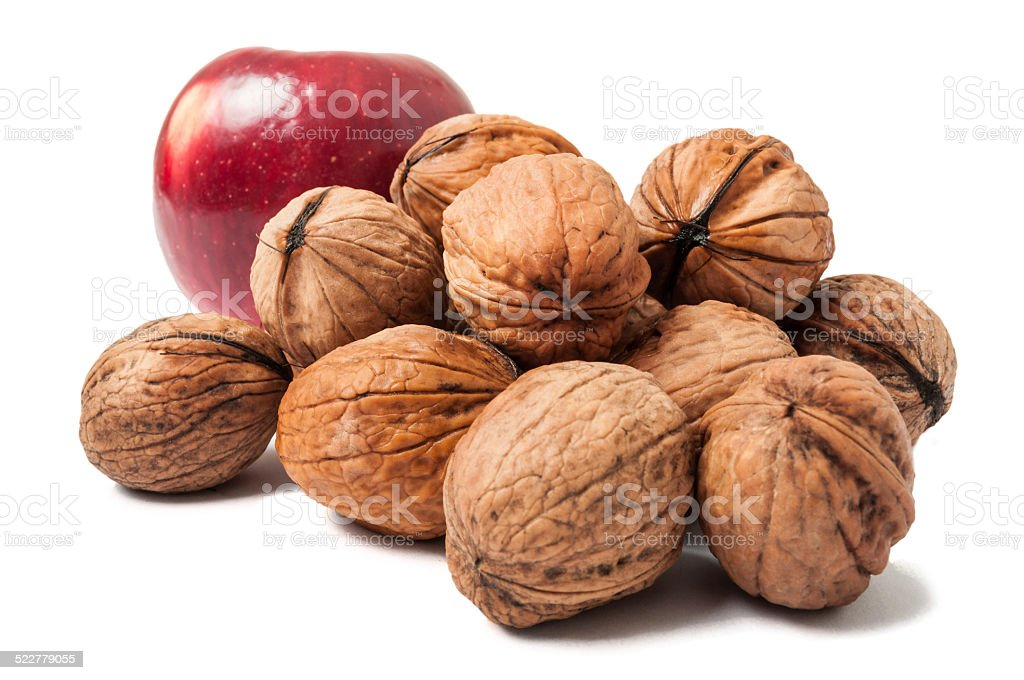 Bunch of walnuts and an apple stock photo