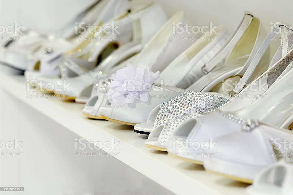 Bunch of white wedding shoes from the right side stock photo