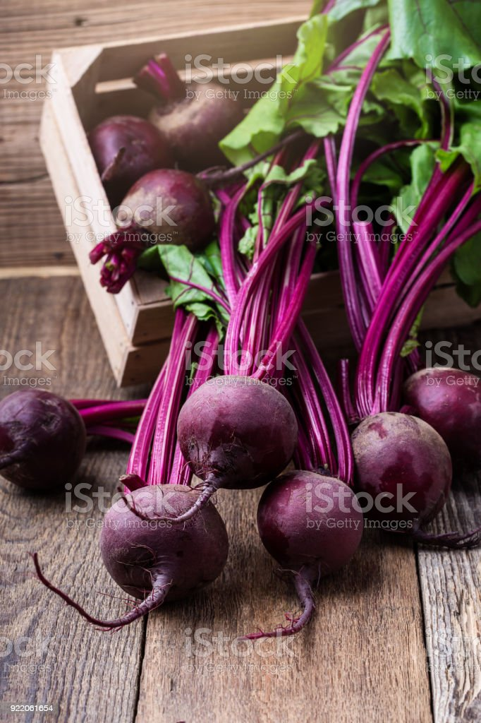 Bunch of whole beetroots with green leaves stock photo