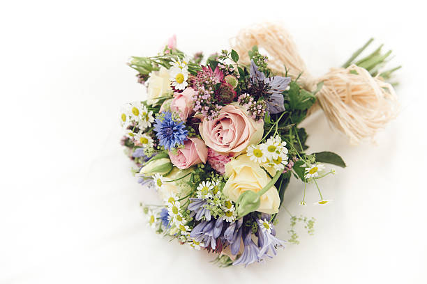Bunch of wild flowers on white (wedding bouquet) stock photo