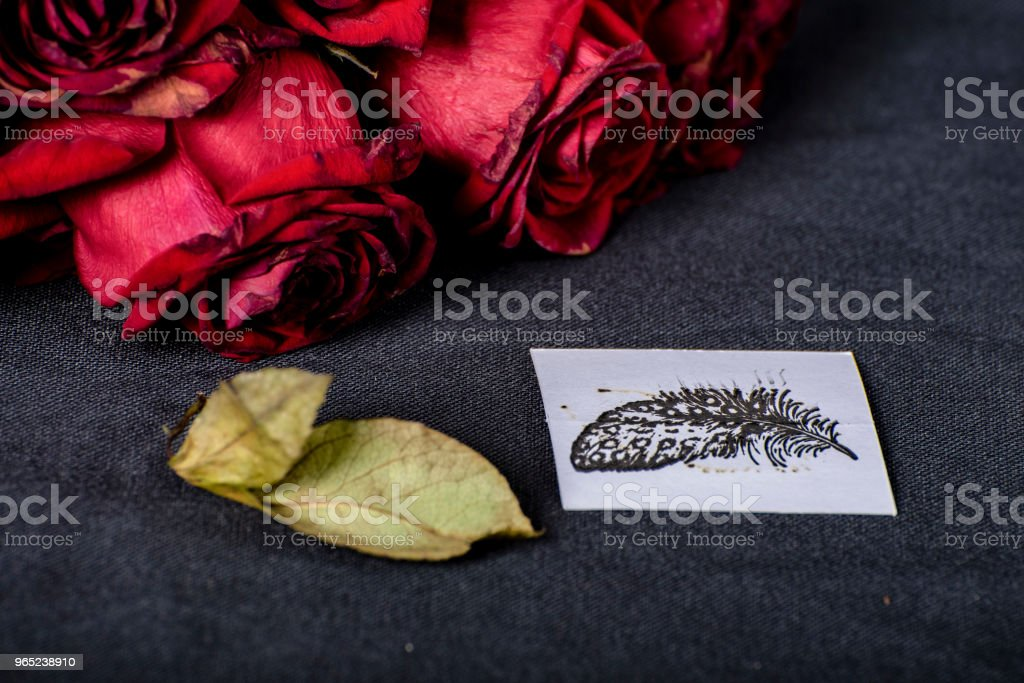 Bunch of wilting red roses and hand made card. zbiór zdjęć royalty-free