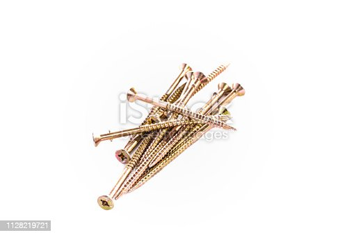 Bunch of yellow zinc coated philips screws on white background