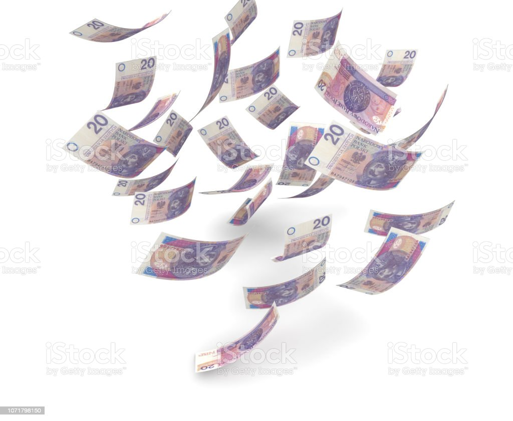 A bunch of zloty bills falling from the sky stock photo