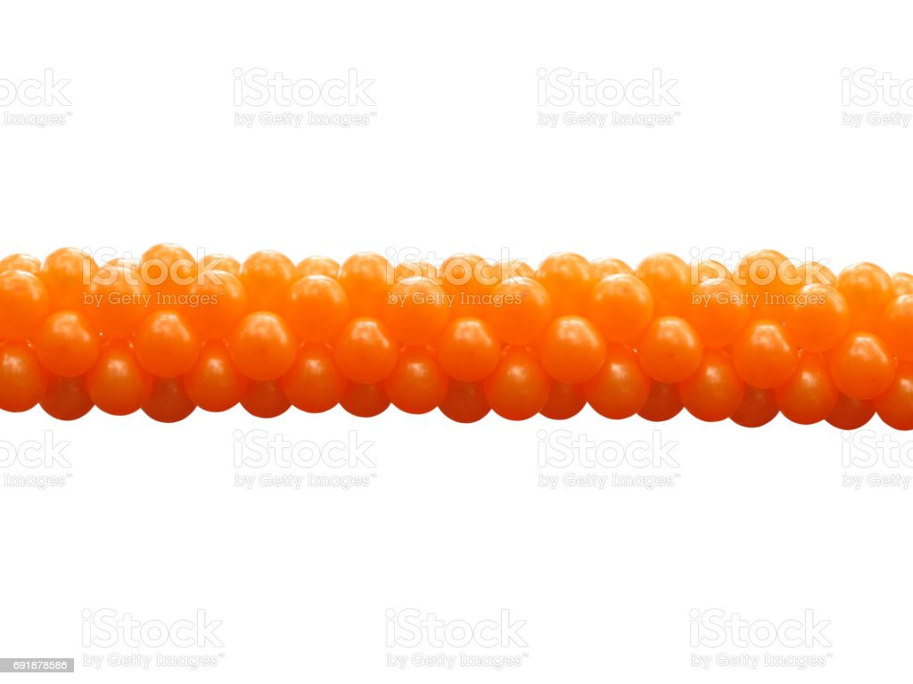 A bunch orange party balloons isolated stock photo
