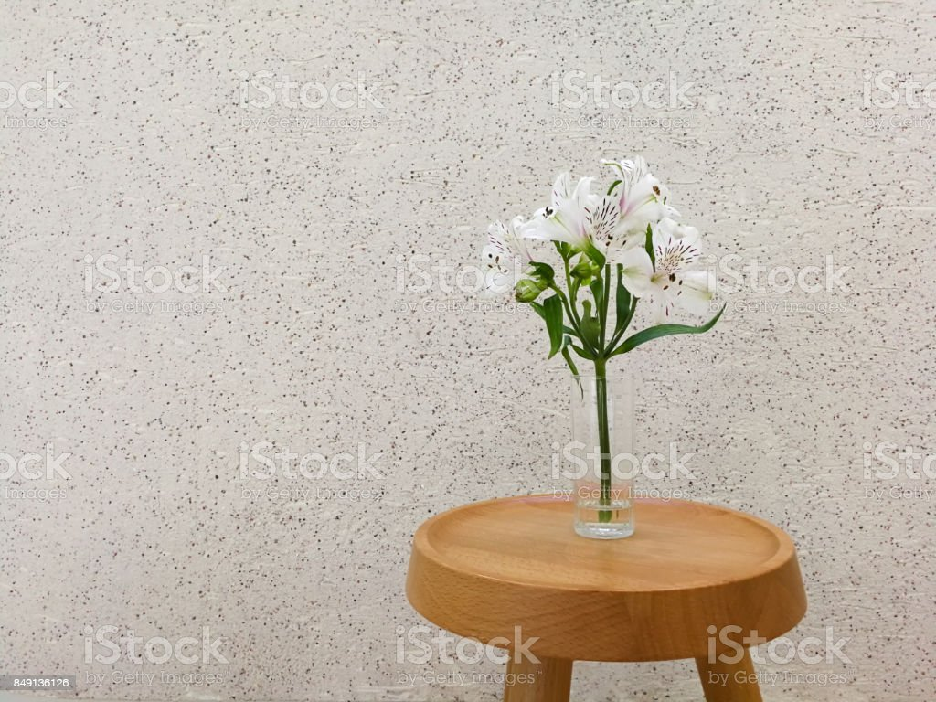 Bunch White Flower In A Vase On Wooden Table With Concrete Texture
