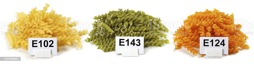 Bunches of artificially colored pasta stock photo
