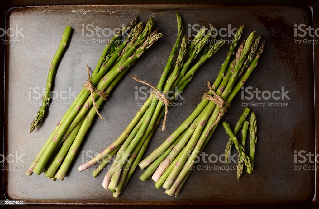 Bunches of Asparagus on Cooking Sheet royalty-free stock photo