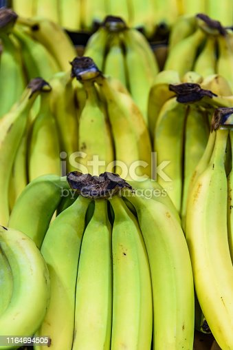 Bunches of Bananas are for sale at the fruit and vegetable section of the Queen Victoria Market in Melbourne Australia