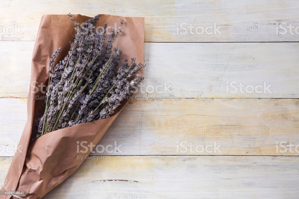 Bunches of lavender on wooden table stock photo