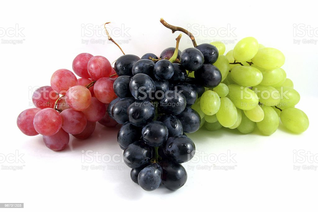 Bunches of red, black and green grapes on white stock photo