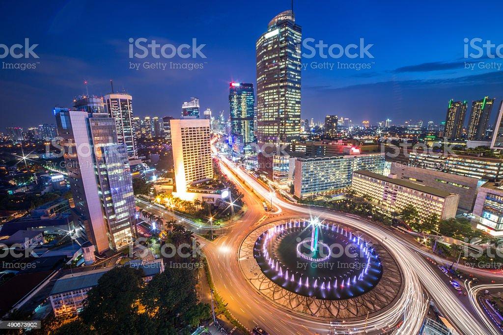 "Bundaran HI Jakarta Landmark at Night Selamat Datang Monument (Selamat Datang is Indonesian for ""Welcome""), also known as the Monumen Bundaran HI or Monumen Bunderan HI, is a monument located in Central Jakarta, Indonesia. Completed in 1962, Selamat Datang Monument is one of the historic landmarks of Jakarta. 2015 Stock Photo"