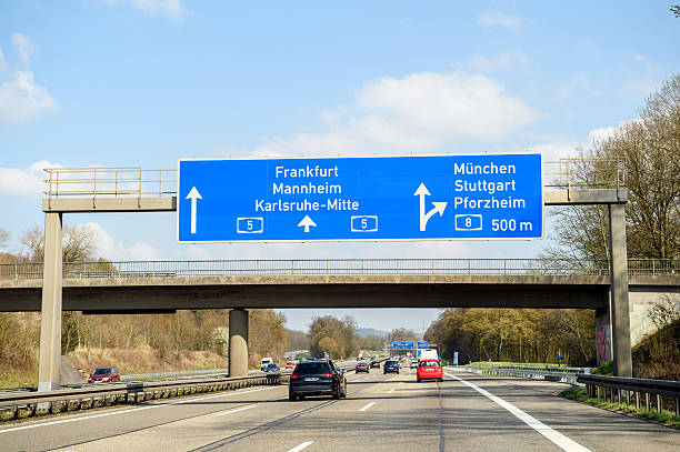 Bundesautobahn or Federal Motorway Frankfurt, Germany - March 26, 2016: Bundesautobahn or Federal Motorway highway street signs to Frankfurt, Mannheim, Karsruhe, Munchen, Stuttgart, Pforzheim singen stock pictures, royalty-free photos & images