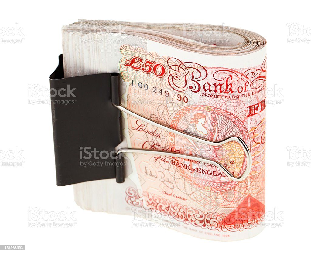Bundle of 50 pound sterling bank notes fasten with clip royalty-free stock photo