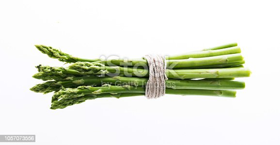 A bundle of asparagus on white background.