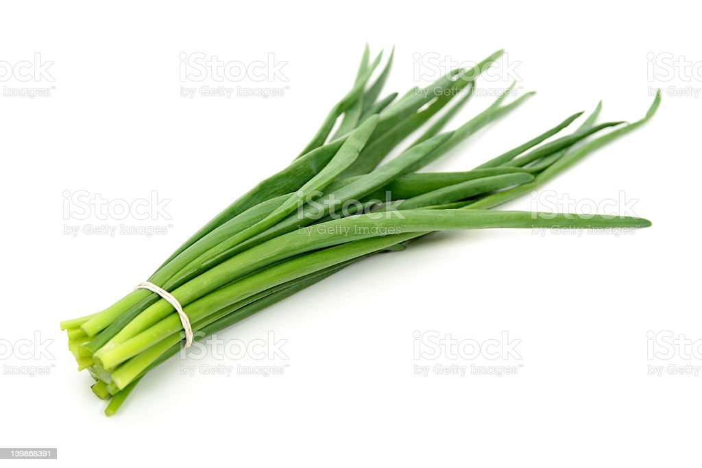 A bundle of chives on a white background royalty-free stock photo