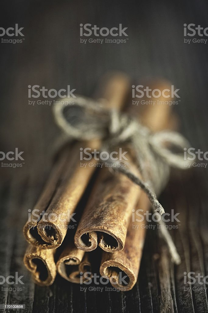 Bundle of cinnamon sticks on a wooden table. royalty-free stock photo