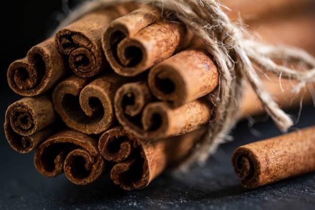 A Bundle of Cinnamon Sticks on Slate stock photo