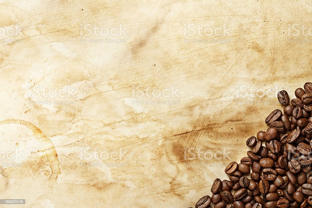 A bundle of coffee beans on a stained background stock photo