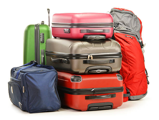 A bundle of colorful suitcases and bags stock photo