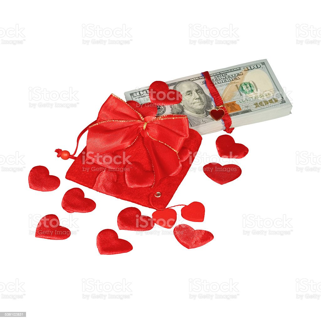 Bundle of dollars in red pouch with red bow stock photo