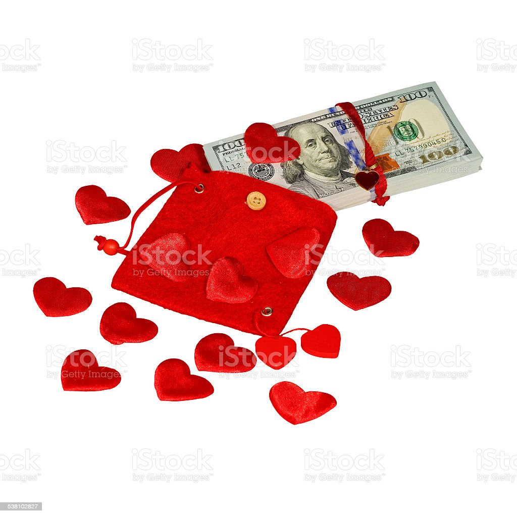 Bundle of dollars in red purse stock photo