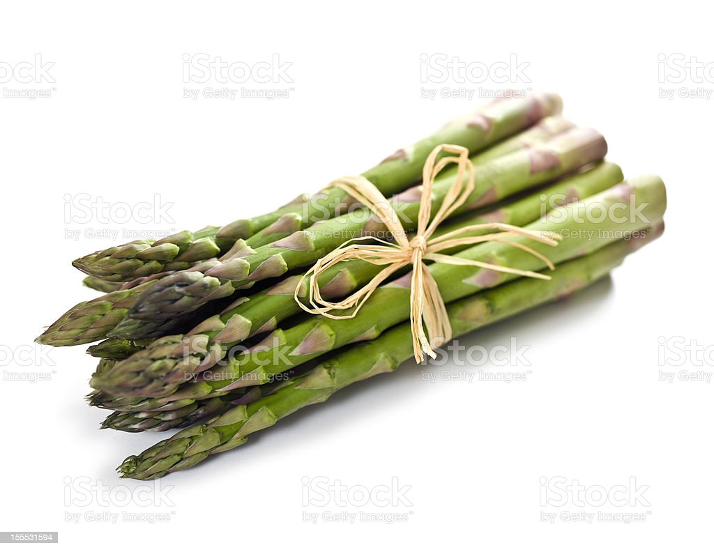 A bundle of green asparagus on a white background  royalty-free stock photo