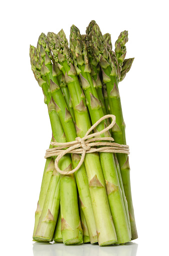 istock Bundle of green asparagus shoots, upright standing 957905600