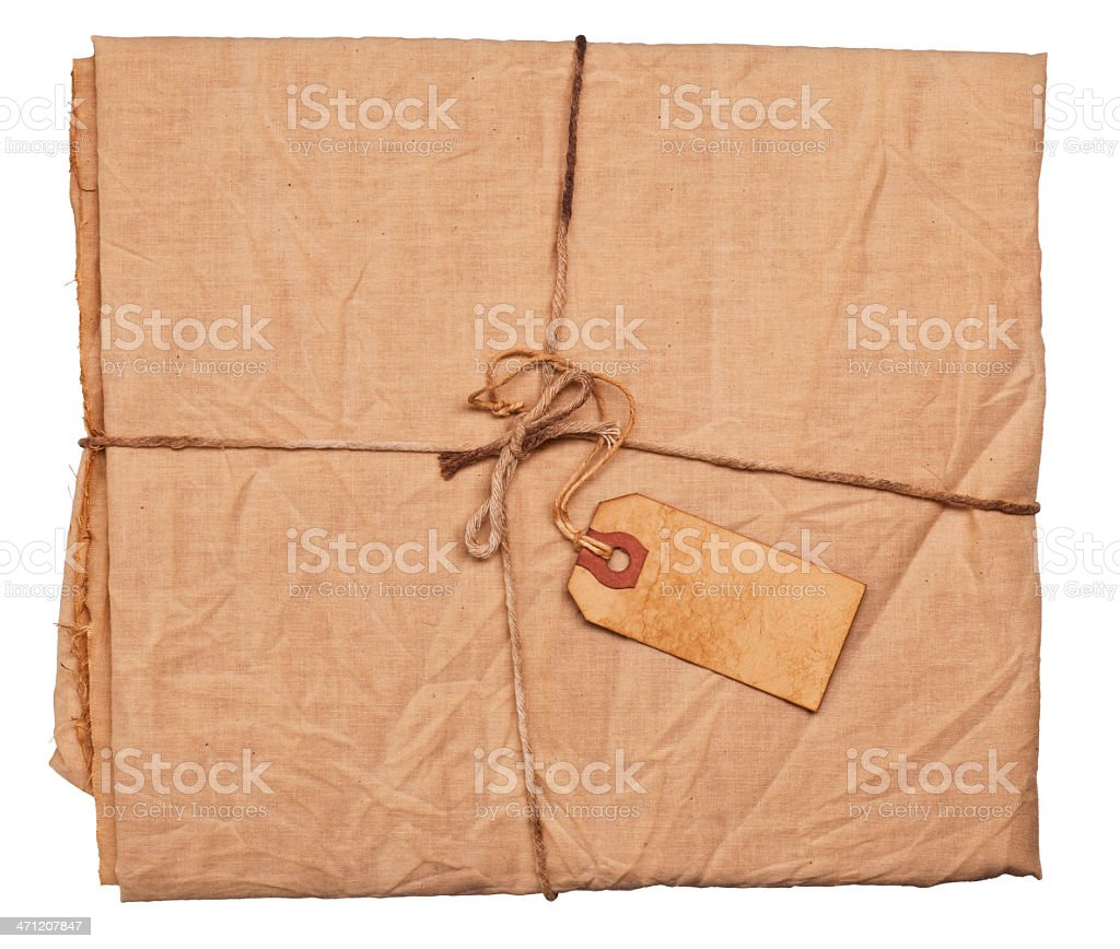 Bundle of Grungy Muslin Cloth Tied With Aged Twine stock photo