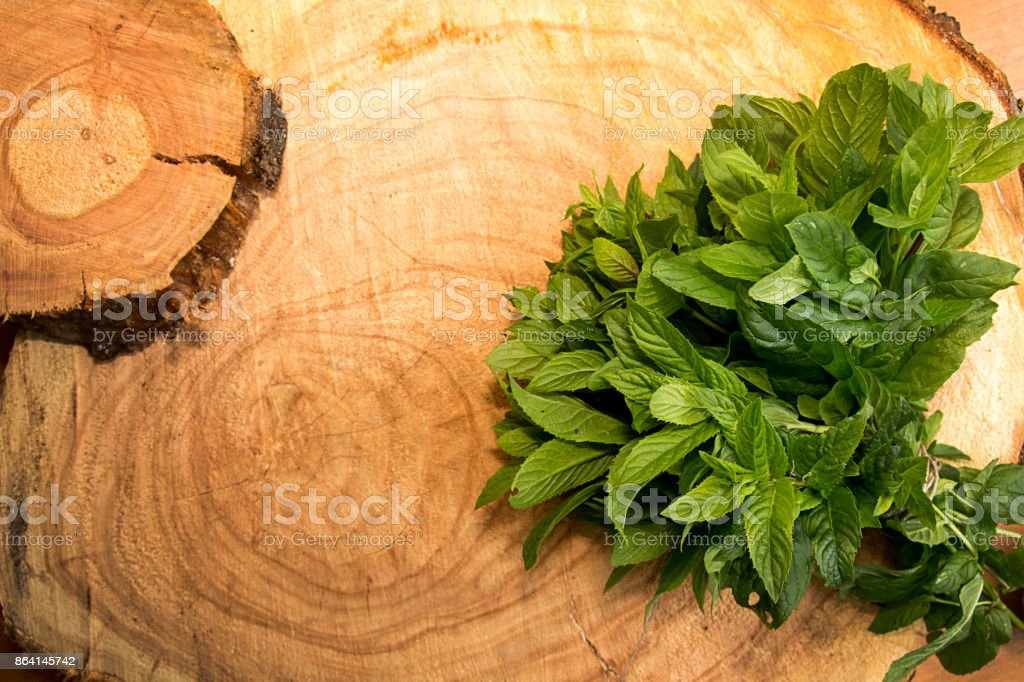 Bundle of mint on old wooden background. Copy space. royalty-free stock photo