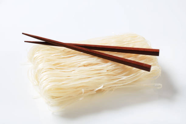 Bundle of rice noodles Bundle of dried rice noodles and wooden chopsticks rice noodles stock pictures, royalty-free photos & images