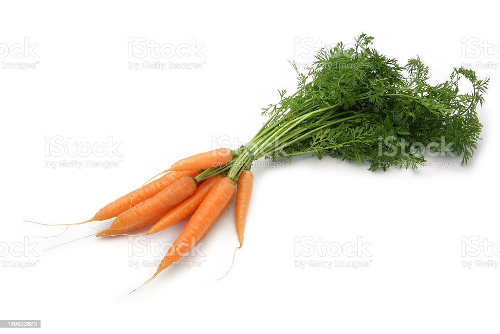 Bundle of small carrots on white background royalty-free stock photo