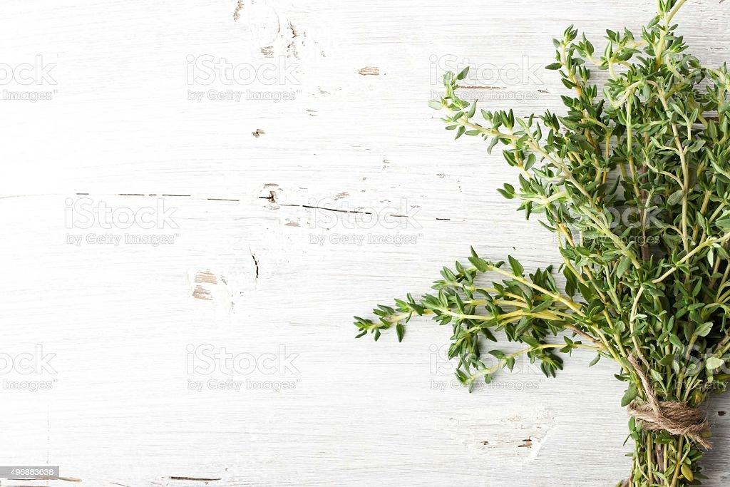 Bundle of thyme on the white board horizontal stock photo